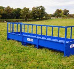 Barrier trough feeder
